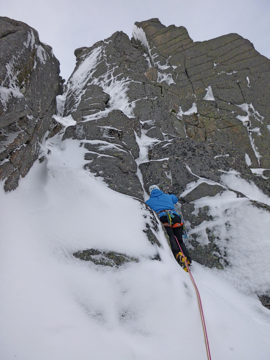 Dave starting up Anvil Gully with a dry looking Anvil Corner looming above
