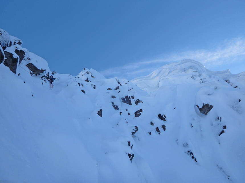 Davie on the left dwarfed by the cornice looming over Polyphemus Gully