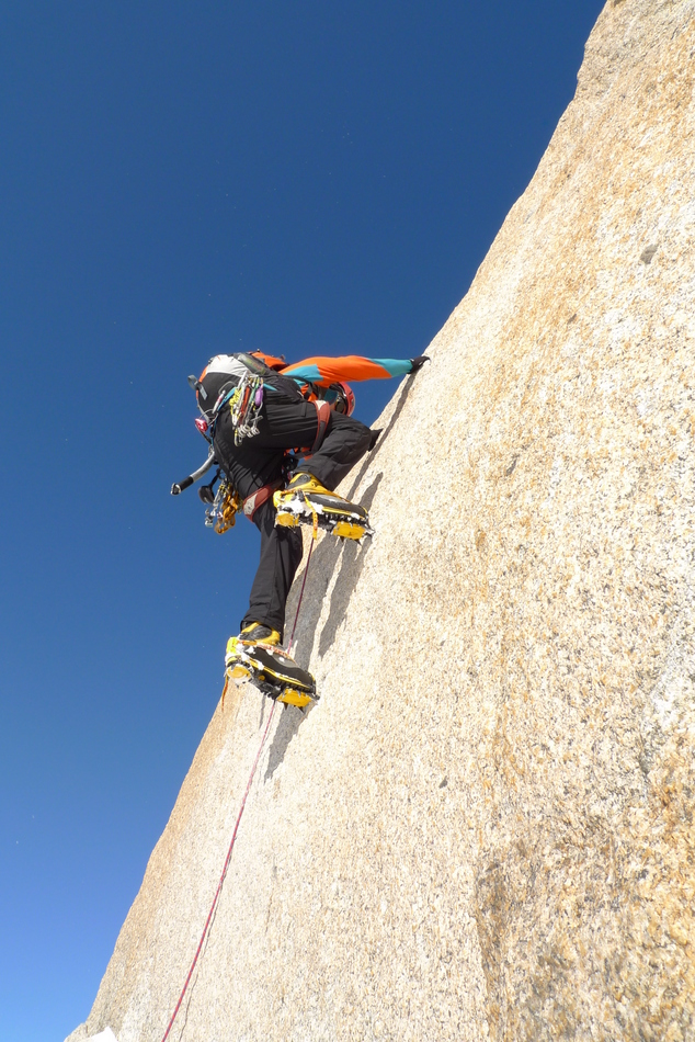 Adam getting stuck into the crux of the Cosmiques Arête