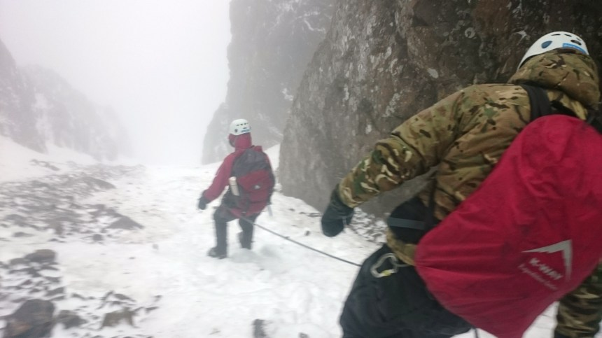 Descending. There is a little scree coming through were the snow is thin making things a little less secure