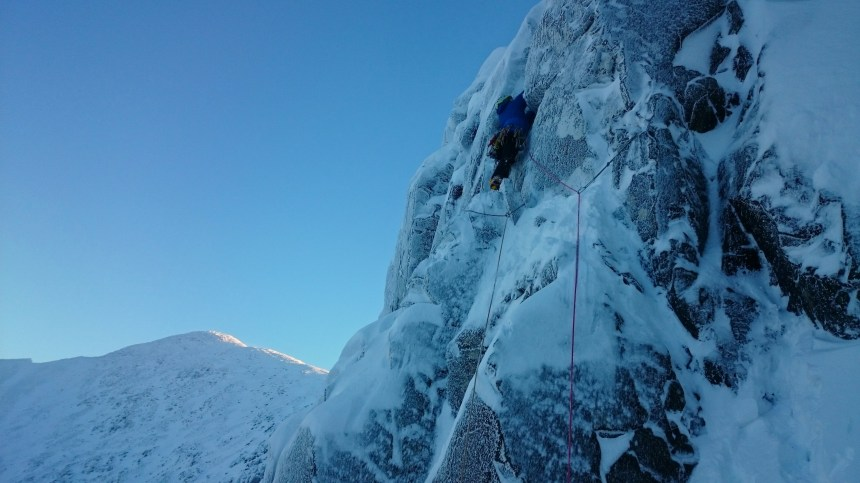 Ken on the first pitch of Direct Route - unconsolidated snow and unfrozen turf made for a bold lead