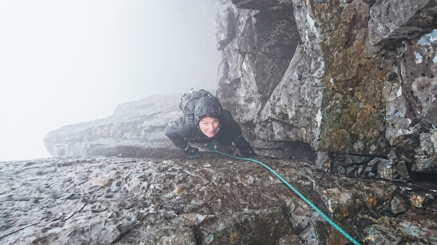 Paul at the top of a wet Kings Chimney
