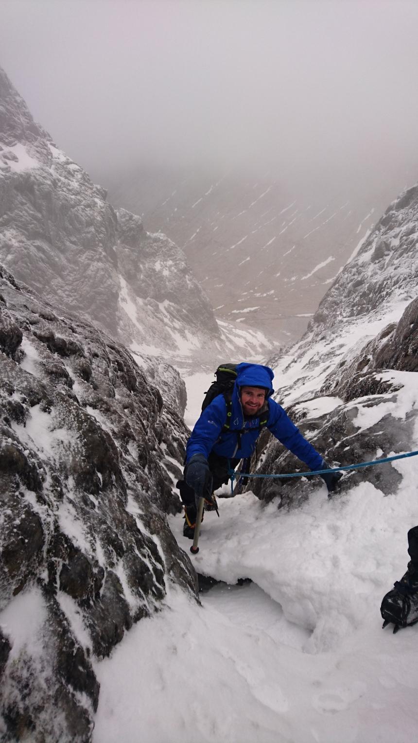 Kieron climbing through a narrow section under Garyloo